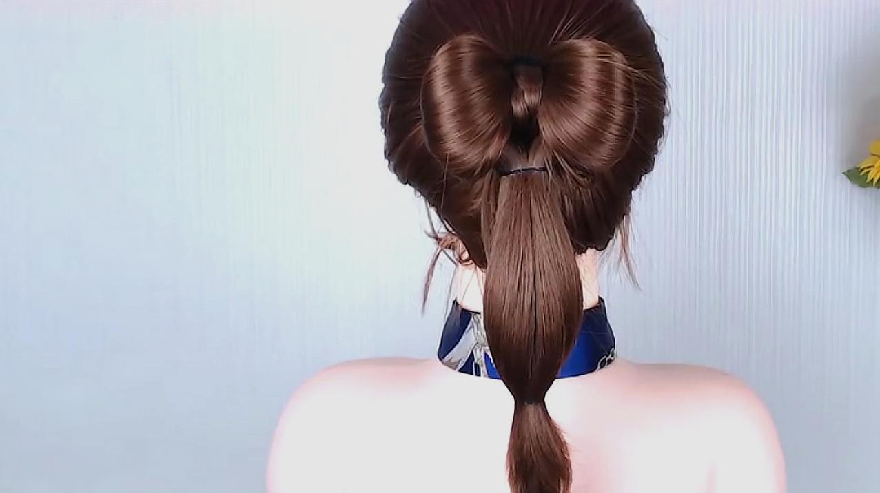 甜美创意的高马尾发型,蝴蝶结扎法优雅又时尚,特别女神范!