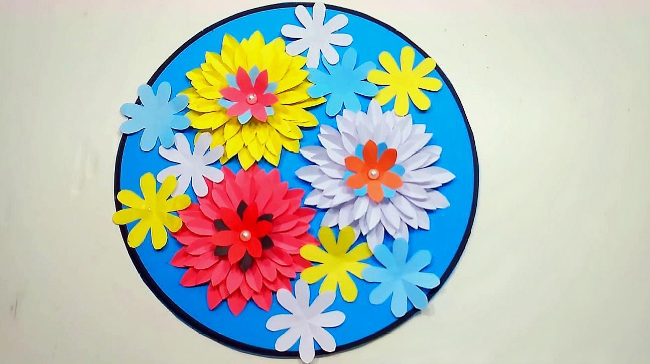 制作简洁漂亮的圆盘纸花墙饰墙挂 4这款纸花非常的简单,只需一张纸