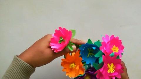 儿童创意手工:幼儿园简易剪纸手工,制作漂亮的花朵!图片