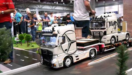 RC模型爱好者展示制作精良的微型工程车
