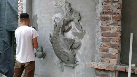 看高手是如何在外墙上用水泥雕刻出一条鱼儿的,这手艺不服不行