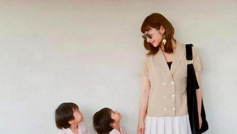 宝妈独自一人带双胞胎,前后各背一个,隔着屏幕都觉得很心酸