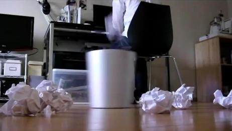 这个垃圾桶厉害,闭着眼垃圾随便扔,它都能给你接住